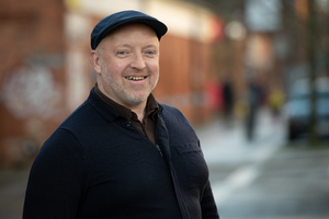 Man with flat cap smiling