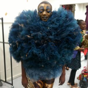 Female in blue theatre costume