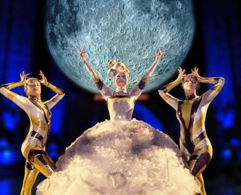 3 FEMALE DANCERS IN FRON OT MOON